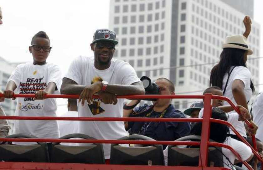 LeBron James celebrates the Miami Heat's NBA championship at the team's victory parade.