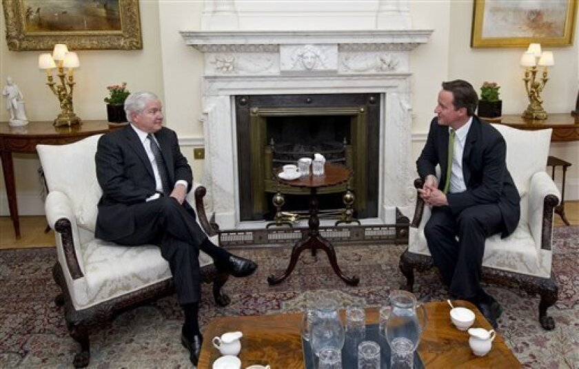 Britain's Prime Minister, David Cameron, right talks with U.S. Secretary of Defense Robert Gates, during their meeting in 10 Downing Street, central London on Monday June 7, 2010. (AP Photo/Carl Court/Pool)