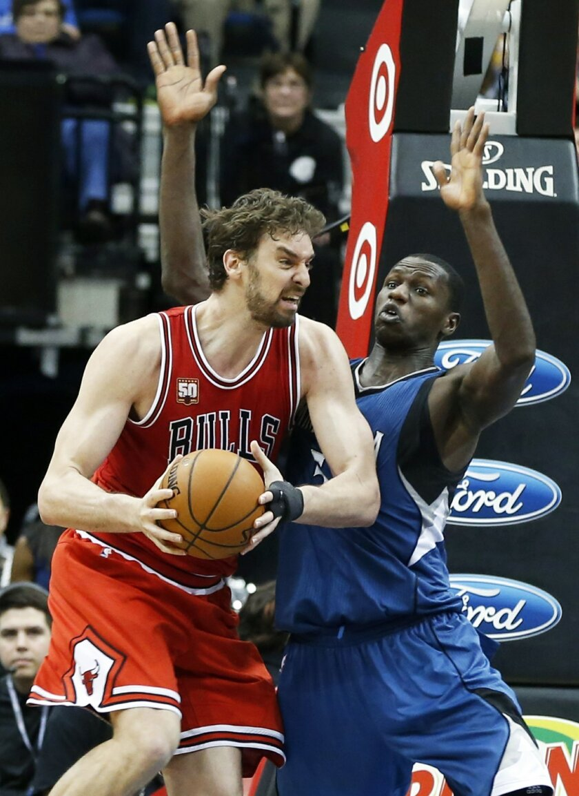 Chicago Bulls' Pau Gasol, left, of Spain, tries to work around Minnesota Timberwolves' Gorgui Dieng of Senegal in the second half of an NBA basketball game, Saturday, Feb. 6, 2016, in Minneapolis. The Timberwolves won 112-105. Gasol led the Bulls with 25 points while Dieng scored 24 for the Timberw