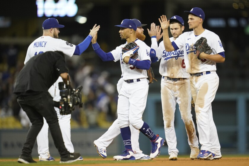"""The Dodgers celebrate an 8-5 victory over the Padres on Thursday, their ninth straight in the """"rivalry."""""""
