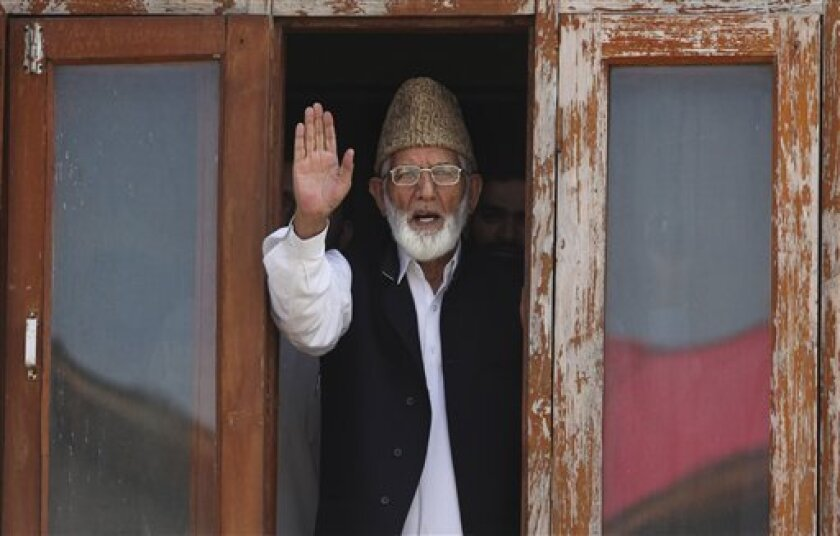 Kashmiri separatist leader Syed Ali Shah Geelani gestures as he speaks to media before his arrest in Srinagar, India, Wednesday, Sept. 8, 2010. Police in Indian-controlled Kashmir arrested Geelani Wednesday in an attempt to stop protests against Indian rule in the disputed region. (AP Photo/Altaf Qadri)