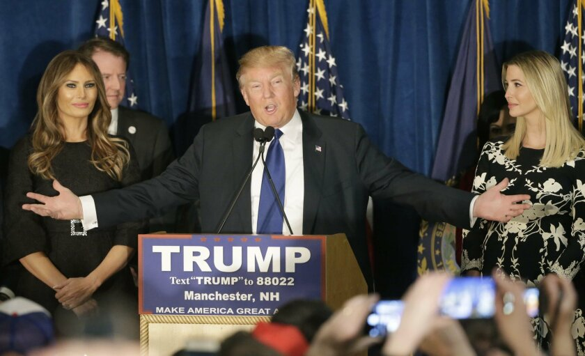Republican presidential candidate, businessman Donald Trump speaks to supporters during a primary night rally, Tuesday, Feb. 9, 2016, in Manchester, N.H. At his side are his wife Melania Trump, left, and daughter Ivanka Trump, right. (AP Photo/David Goldman)