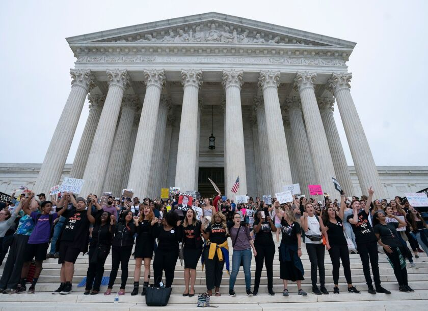 Immigration advocates rally outside the Supreme Court in Washington.