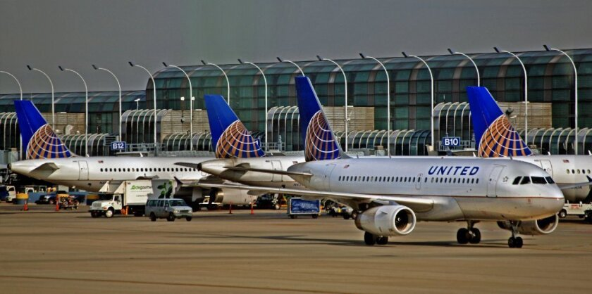 United Airlines planes parked on the tarmac. The airline has added a new system to try to eliminate missed connections by passengers.
