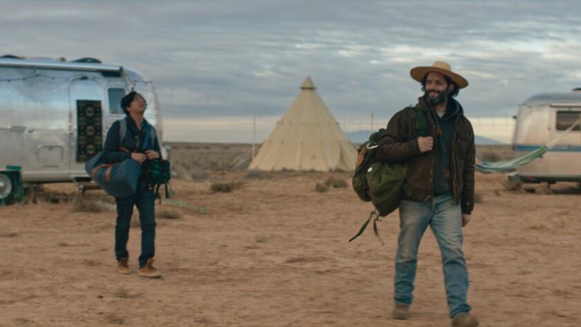 """Tony Revolori, left, and Jason Mantzoukas in the movie """"The Long Dumb Road."""""""