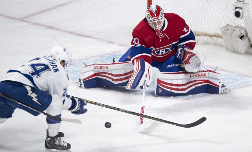 Montreal Canadiens goalie Ben Scrivens makes a save off Tampa Bay Lightning's Ryan Callahan during the first period of an NHL hockey game, Tuesday, Feb. 9, 2016, in Montreal.  (Paul Chiasson/The Canadian Press via AP) MANDATORY CREDIT