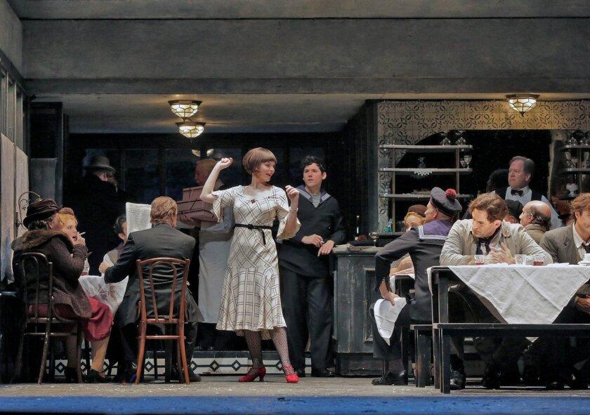 "The San Diego Opera's season-opening production of ""La Boheme"" (with Sara Gartland as Musetta). Photo: Ken Howard"