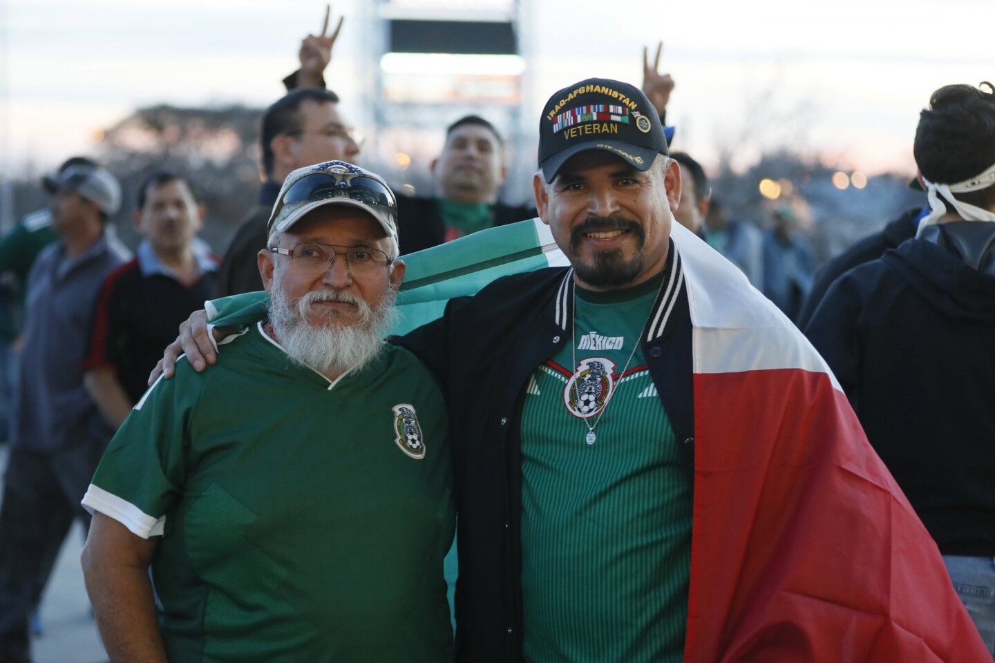 Jan 31, 2018; San Antonio, TX, USA; Mexican fans Martin (left) and Carlos Urrutia pose for a photo prior to the start of the match between Mexico and Bosnia and Herzegovina at San Antonio Alamodome. Mandatory Credit: Soobum Im-USA TODAY Sports ** Usable by SD and OS ONLY **