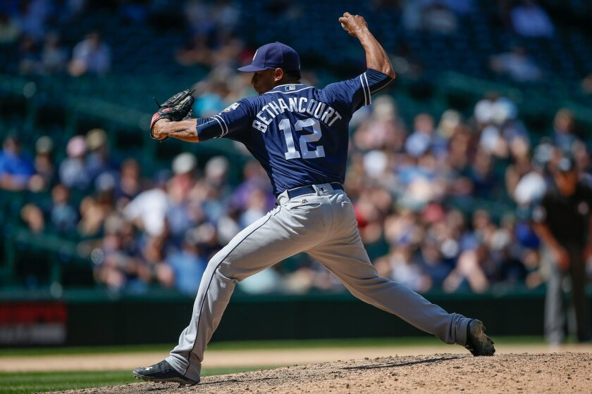 Starting catcher Christian Bethancourt #12 of the San Diego Padres makes an appearance as a relief pitcher against the Seattle Mariners in the eighth inning at Safeco Field on May 31, 2016 in Seattle, Washington. (Photo by Otto Greule Jr/Getty Images)