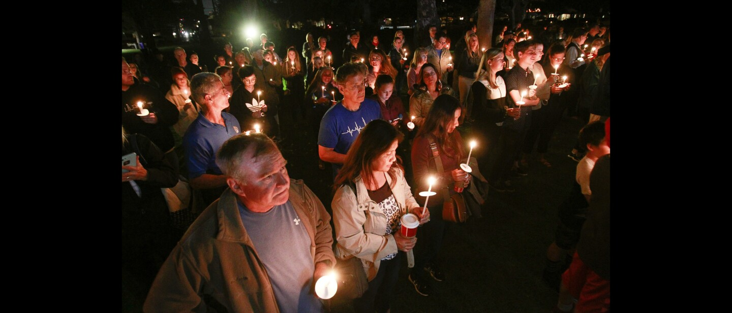 People gather for candlelight vigil for Justin Meek, 23, at Spreckels Park in Coronado.