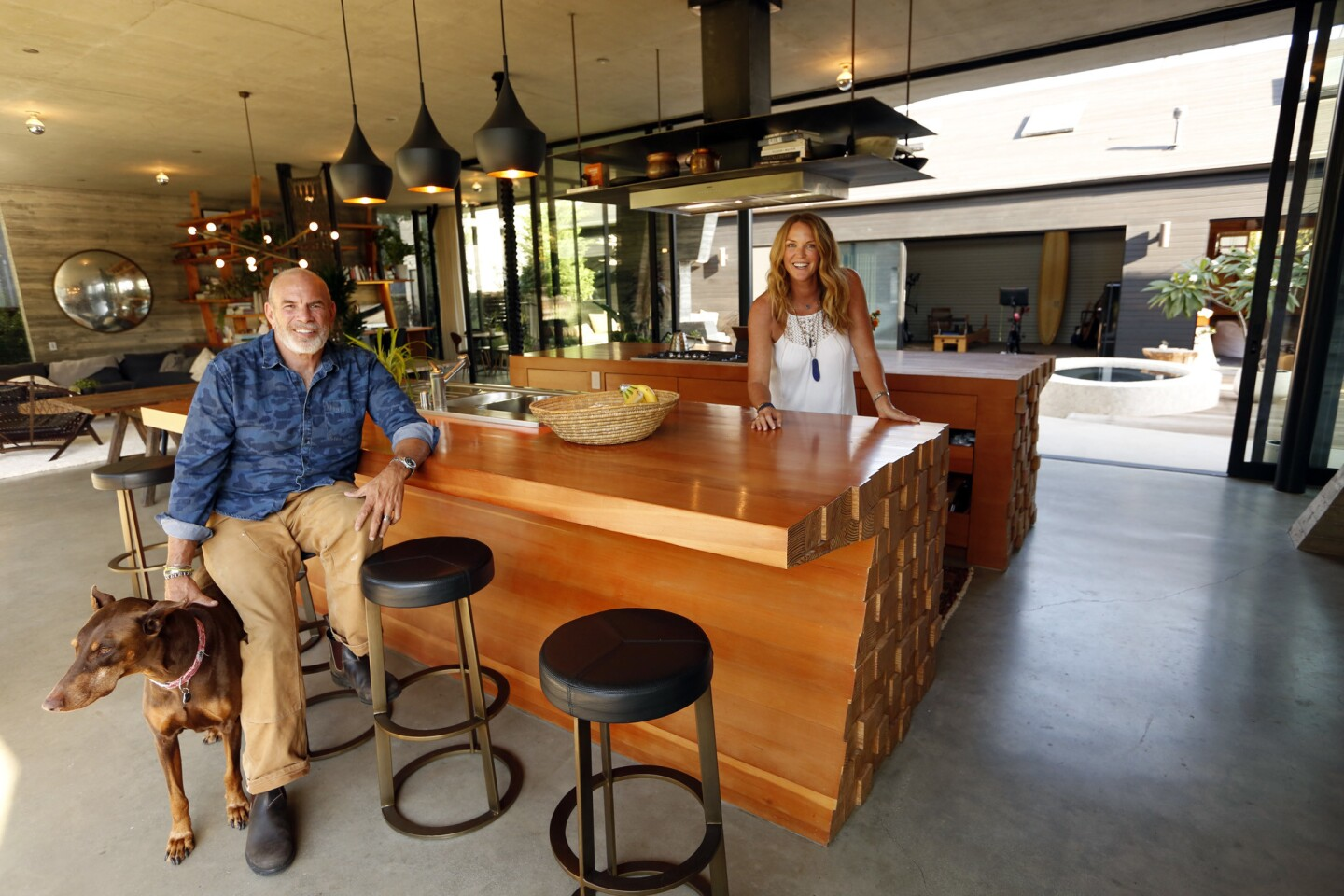 Paul Hibler, his wife, Tiffany Rochelle, and their dog, Maya, spend time in the kitchen of their Venice home that was designed by architect Kulapat Yantrasast of Why. (Yantrasast recently completed the Marciano Art Foundation on Wilshire Boulevard.)