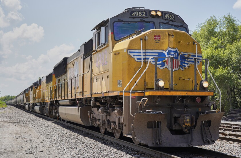 FILE- In this July 31, 2018, file photo a Union Pacific train travels through Union, Neb. A federal judge has ruled that the nation's four largest railroads can't exclude details of their conversations from lawsuits challenging billions of dollars of charges the railroads imposed in the past. The ruling on Friday, Feb. 19, 2021, undercuts one of the defenses Union Pacific, BNSF, CSX and Norfolk Southern had offered in dozens of lawsuits major companies filed last year questioning the way railroads set rates. (AP Photo/Nati Harnik, File)