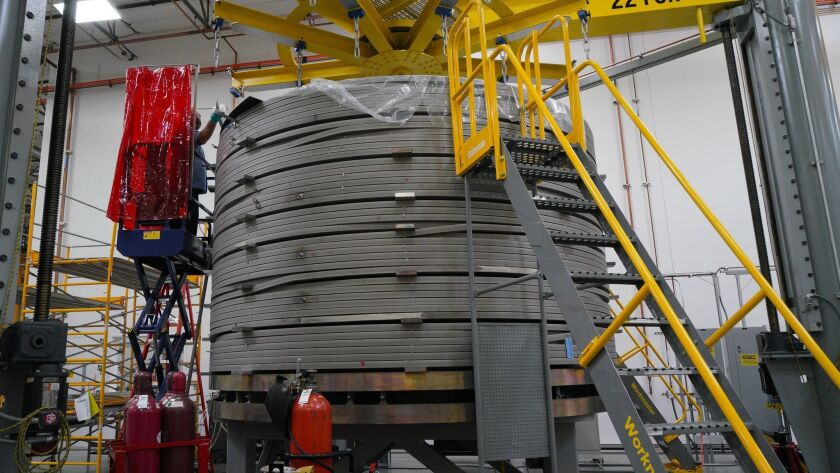 One of seven Central Solenoid modules being built by General Atomics as part of the ITER fusion energy project. Seven segments are spliced together to make a continuous coil. At this stage, the coil weighs 225,000 pounds.