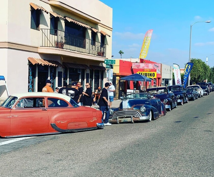 Lowriders lined a street outside Esquina Vintage and Coffee during the grand opening on Oct. 13.
