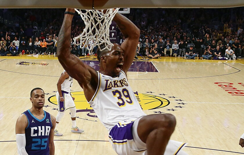 Lakers center Dwight Howard slam dunks during the second half of a 120-101 victory over the Charlotte Hornets at Staples Center on Oct. 27, 2019.