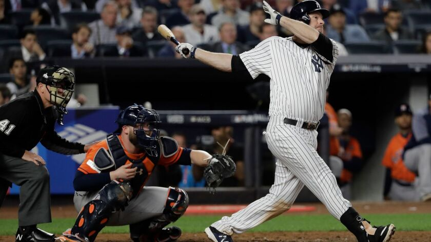 New York Yankees' Chase Headley hits a double during the sixth inning of Game 5 of baseball's Americ