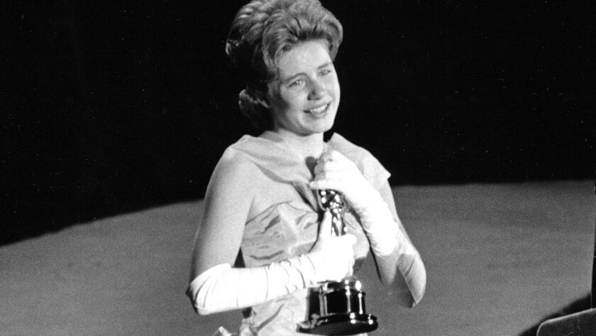 """In 1963, actress Patty Duke, 16, accepts the Oscar as supporting actress for her work in """"The Miracle Worker"""" at the annual Academy Awards in Santa Monica."""