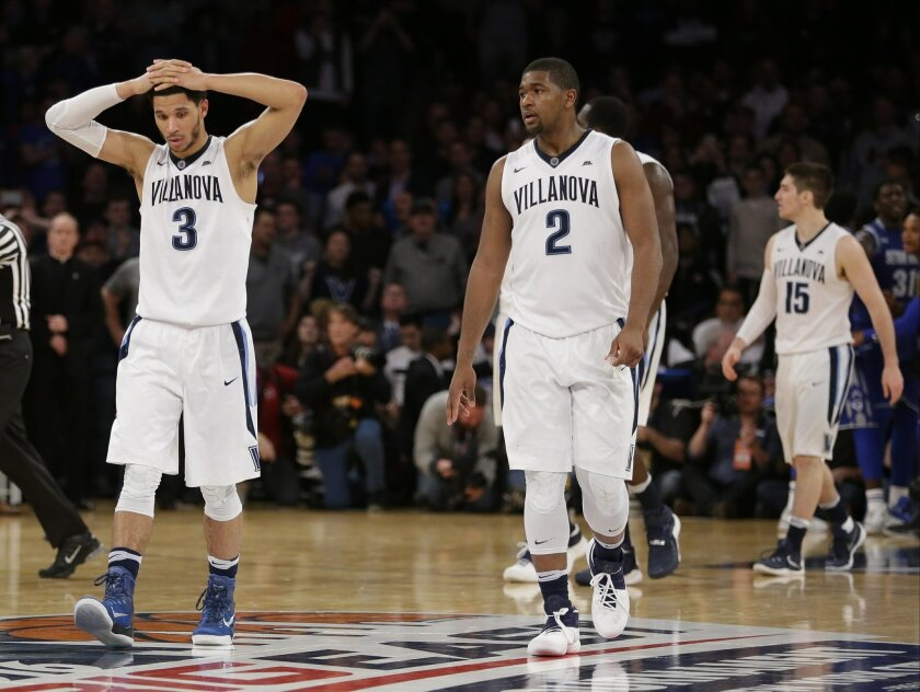Villanova's Josh Hart (3), Kris Jenkins (2) and Ryan Arcidiacono (15) react during the second half of an NCAA college basketball game during the Big East men's tournament against Seton Hall Saturday, March 12, 2016, in New York. Seton Hall won 69-67. (AP Photo/Frank Franklin II)