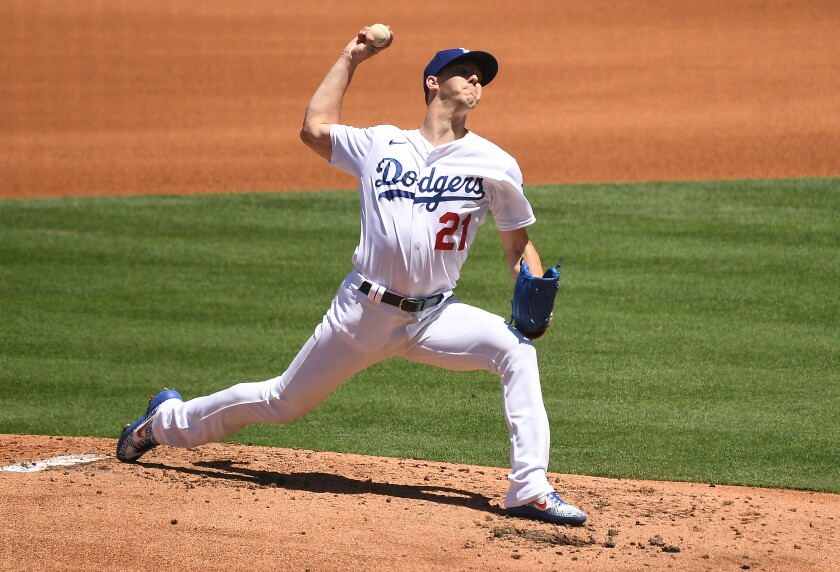 Dodgers pitcher Walker Buehler throws a pitch during Sunday's win over the San Francisco Giants.