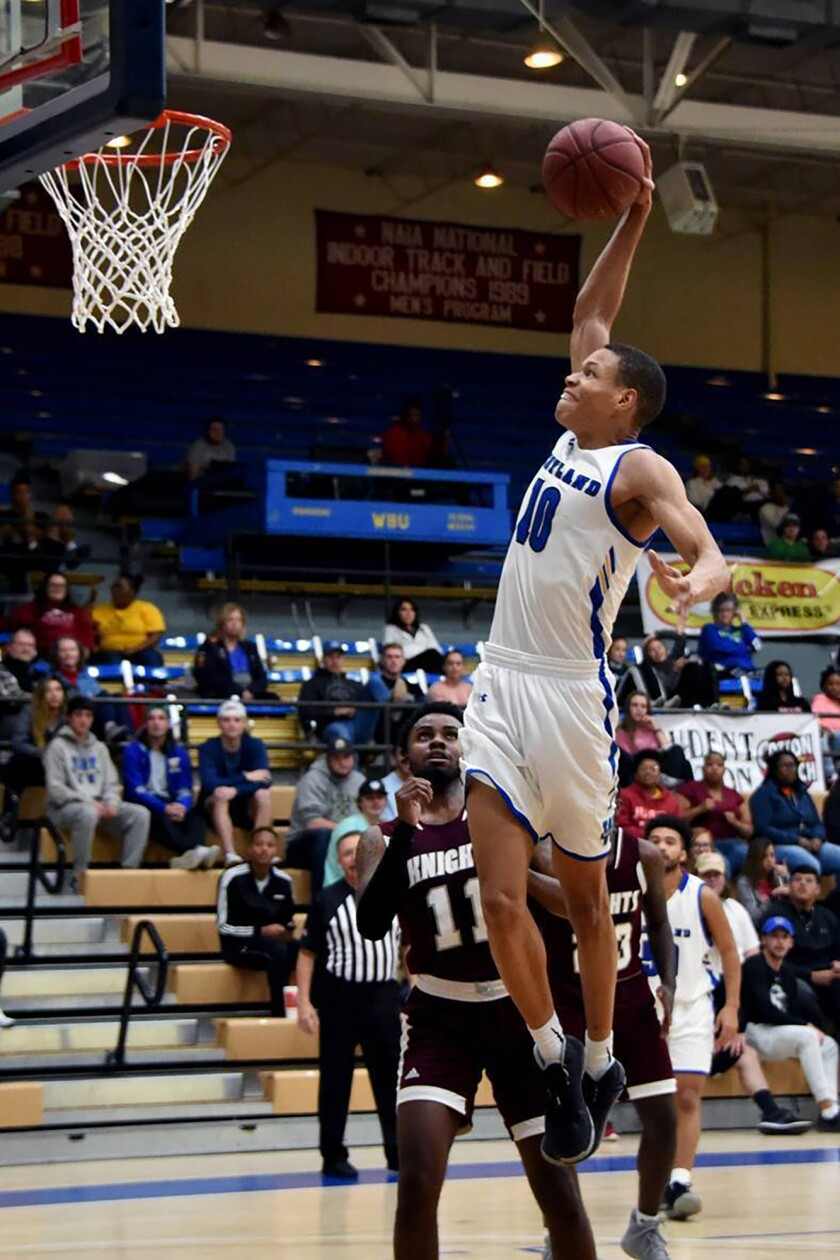 In this photo provided by Wayland Baptist University, Wayland Baptist guard J.J. Culver (10) shoots during an NAIA college basketball game against Southwestern Adventist, Tuesday, Dec. 10, 2019, in Plainview, Texas. Culver became the fourth college basketball player to score 100 or more points in a game, reaching the century mark in a 124-60 win over Southwestern Adventist on Tuesday night. (Claudia Lusk/Wayland Baptist University via AP)