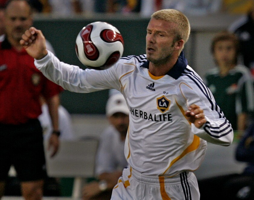 Galaxy star David Beckham keeps an eye on the ball during a match against Chelsea FC on July 21, 2007.