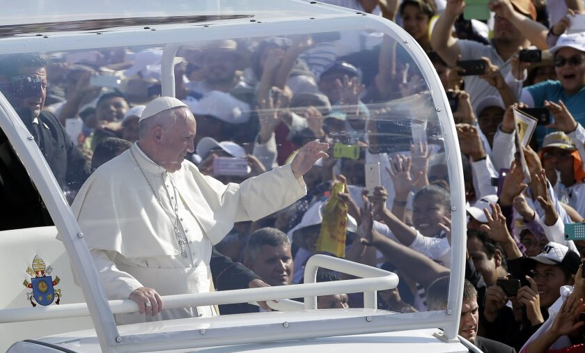 Pope Francis waves from his popemobile as he arrives at Viktor Manuel Reyna stadium in Tuxtla Gutierrez, Mexico, Monday, Feb. 15, 2016.  Francis is celebrating Mexico's Indians on Monday with a visit to Chiapas state, a center of indigenous culture, where he presided over a Mass in three native lan