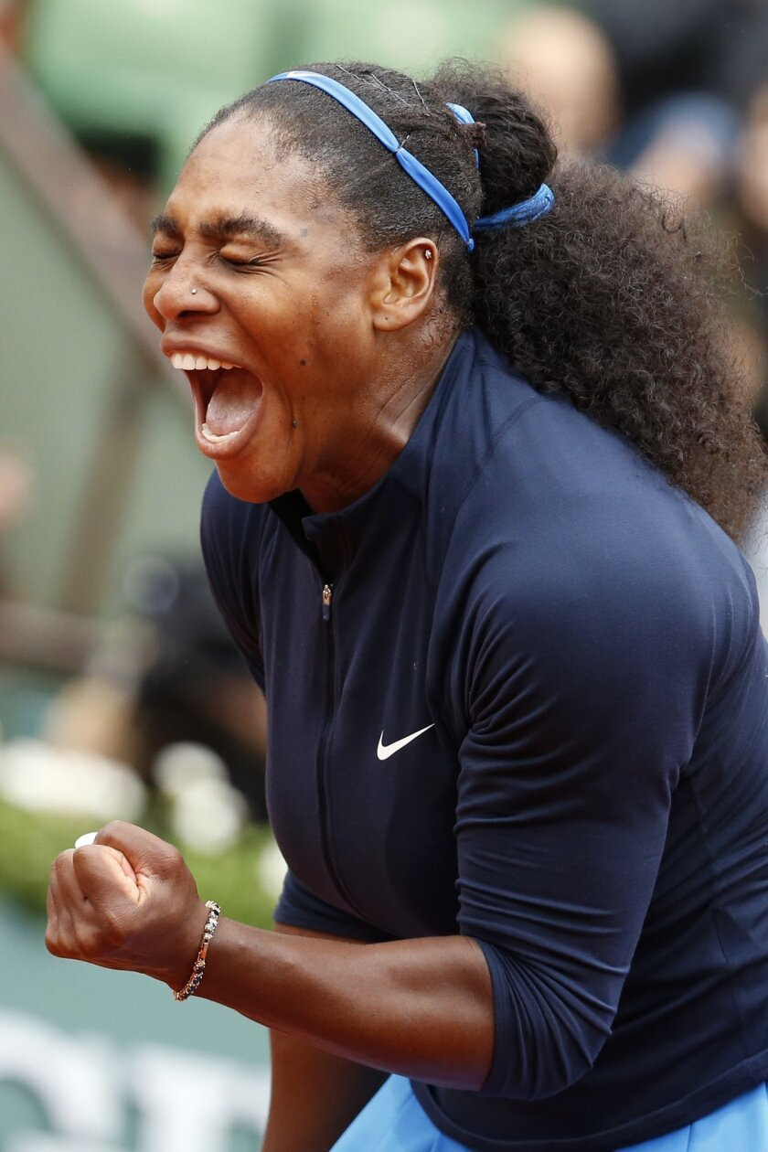 Serena Williams of the U.S. clenches her fist after scoring a point in the semifinal match of the French Open tennis tournament against Netherlands' Kiki Bertens at the Roland Garros stadium in Paris, France, Friday, June 3, 2016. (AP Photo/Alastair Grant)