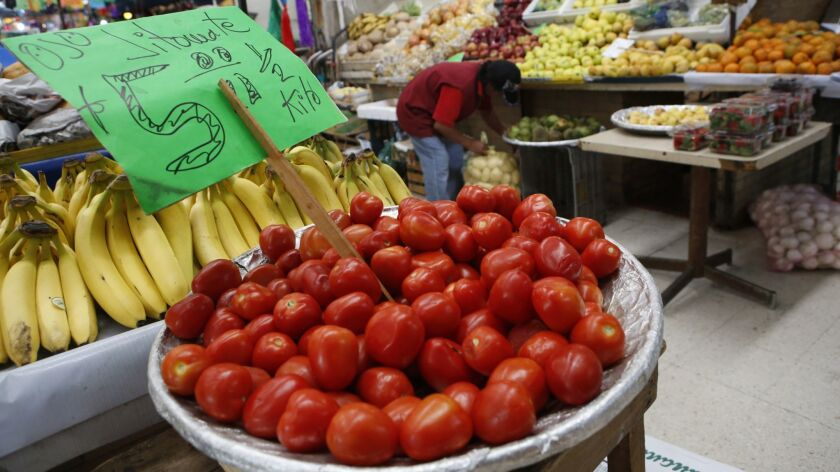 FILE - In this Feb. 2, 2017 file photo, Mexican tomatoes are displayed for sale at a produce stand i