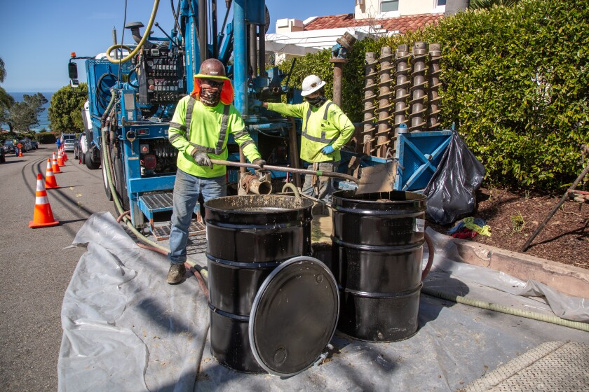 Workers from Tri-County Drilling Inc. take soil samples for studies of potential new routes for railroad tracks in Del Mar.