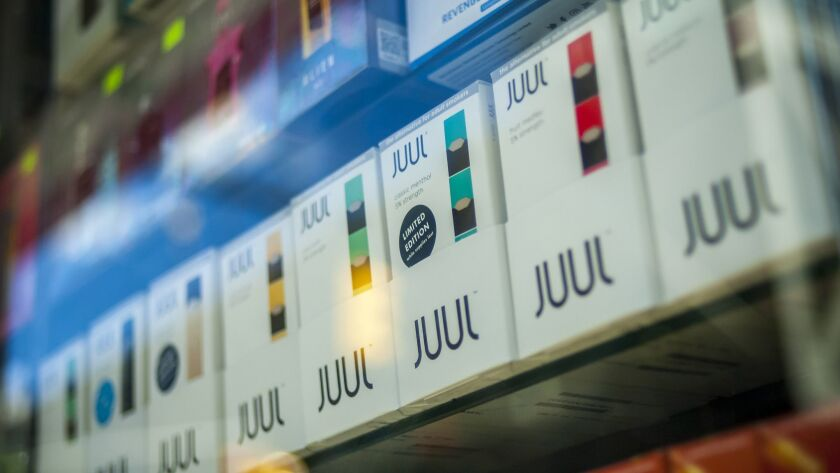 Juul packets lined up on a shelf