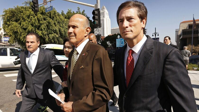 Former Los Angeles County Sheriff Lee Baca with his attorney Nathan Hochman at his side departs the Los Angeles Federal Courthouse after he was found guilty of obstructing a federal investigation into abuses in county jails and lying to cover up the interference.