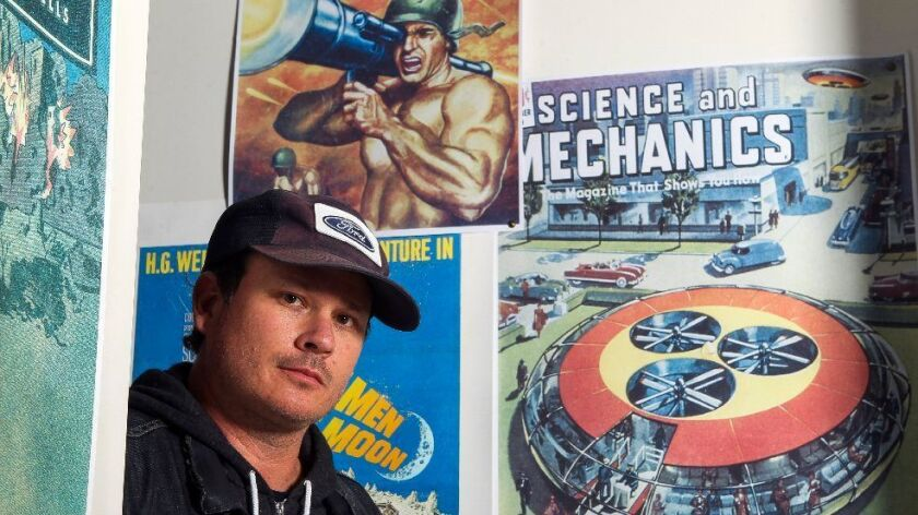 "Blink-182 co-founder Tom DeLonge is shown at his To the Stars headquarters in Encinitas. His new book, ""Sekret Machines: Gods,"" is out this week."