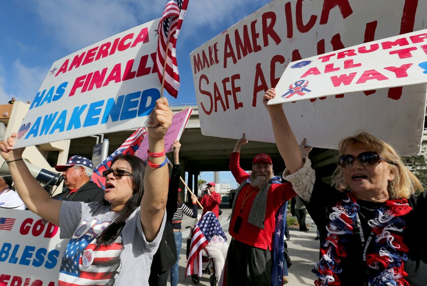 Supporters of President Trump rally in favor of his immigration ban executive order Saturday at Tom Bradley International Terminal at LAX.
