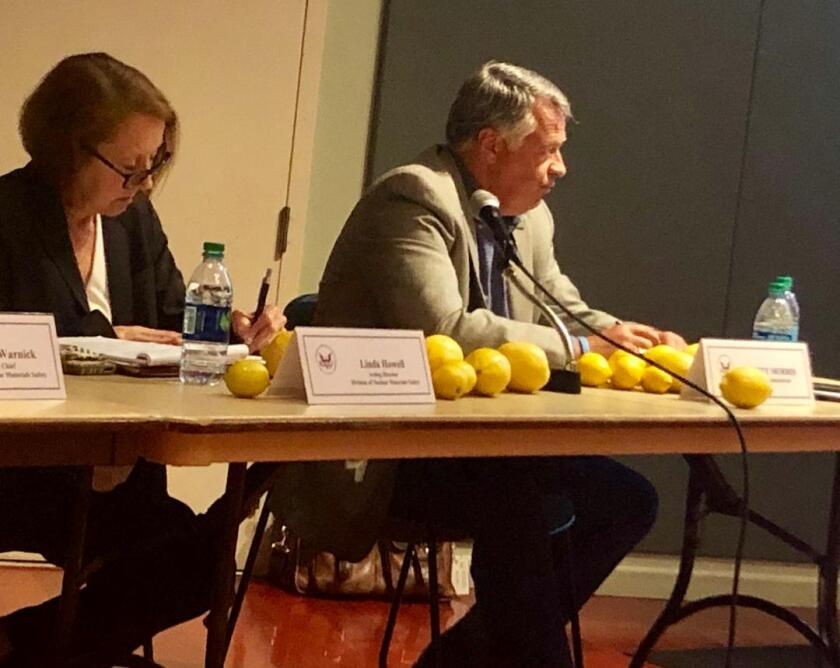 Some attendees at a town hall hosted by the U.S. Nuclear Regulatory Commission in San Juan Capistrano placed lemons on the table of NRC officials Linda Howell (left) and Scott Morris. Critics of a recently constructed dry storage facility at the San Onofre Nuclear Generating Station have called the design a lemon.
