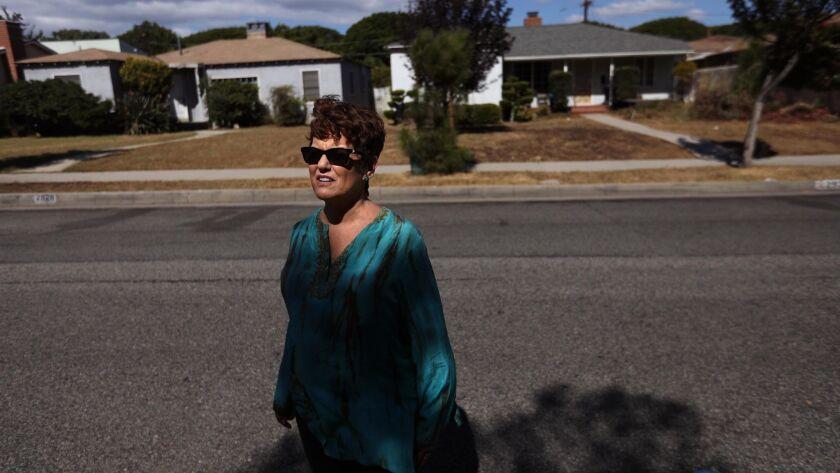 SANTA MONICA, CA - OCTOBER 11, 2018 - - Karen Pomer, 63, a local political activist, stands across t