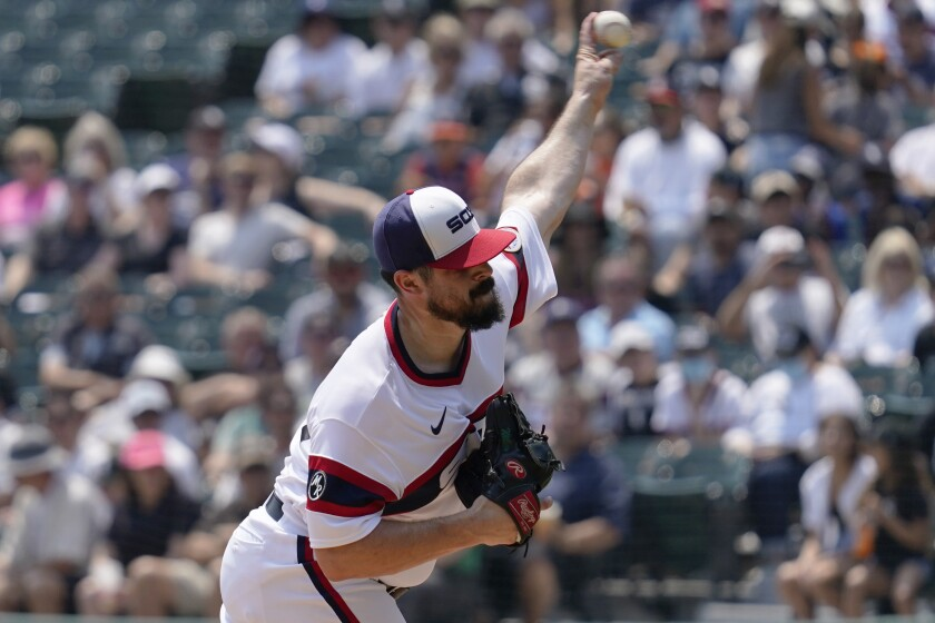 Chicago White Sox starting pitcher Carlos Rodon throws against the Houston Astros during the first inning of a baseball game in Chicago, Sunday, July 18, 2021. (AP Photo/Nam Y. Huh)