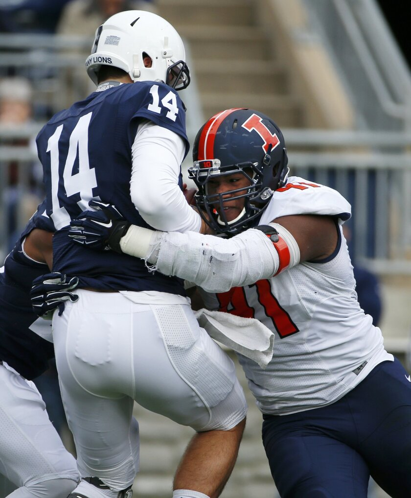 Penn State quarterback Christian Hackenberg (14) is sacked by Illinois defensive end Dawuane Smoot (91) during  the first half of an NCAA college football game in State College, Pa., Saturday, Oct. 31, 2015. (AP Photo/Gene J. Puskar)
