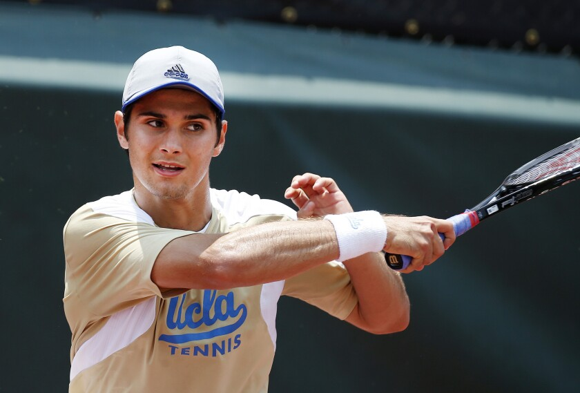 UCLA's Marcos Giron follows through on a forehand return against Pepperdine's Alex Sarkissian during the 2014 NCAA men's single championship match.