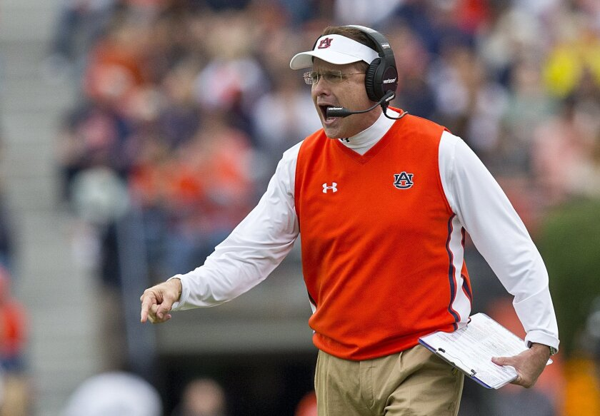 FILE - In this Saturday, Oct. 3, 2015 file photo, Auburn head coach Gus Malzahn yells to his players to get into formation during the first half of an NCAA college football game against Auburn in Auburn, Ala. Steve Shaw has a busy week at the Southeastern Conference's annual meetings. Shaw, the lea