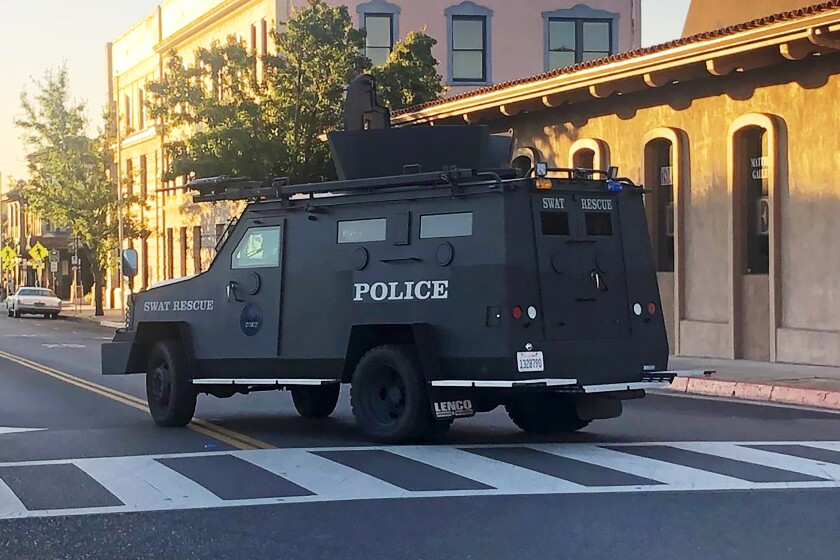 An armored vehicle patrols the streets of Paso Robles after a sheriff's deputy was wounded by a gunman.