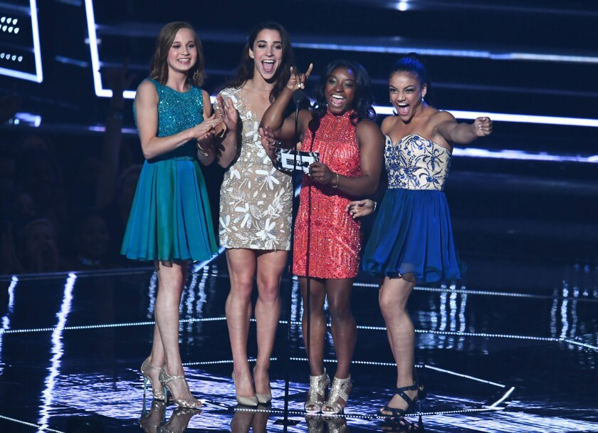 From left, Olympic gymnasts Madison Kocian, Aly Raisman, Simone Biles and Laurie Hernandez present during the 2016 MTV Video Music Awards on Aug. 28 at Madison Square Garden.