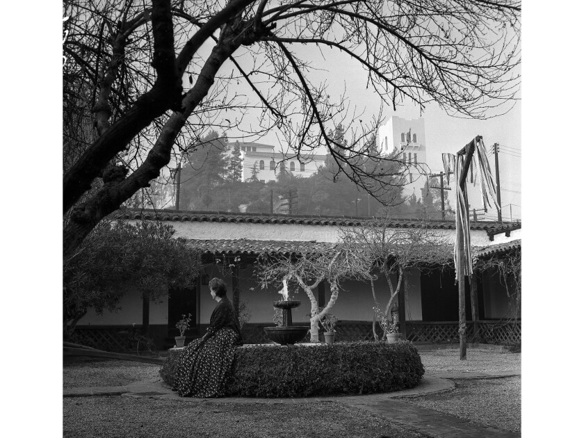 December 1955: In the foreground of the photo is the patio of the Casa de Adobe, a replica of one of the city's first homes. In the background is the Southwest Museum.