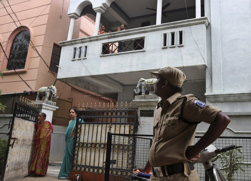 An Indian police officer stands outside the Hyderabad residence of one of the Indian nationals who went missing in the Libyan city of Sirte on July 30.