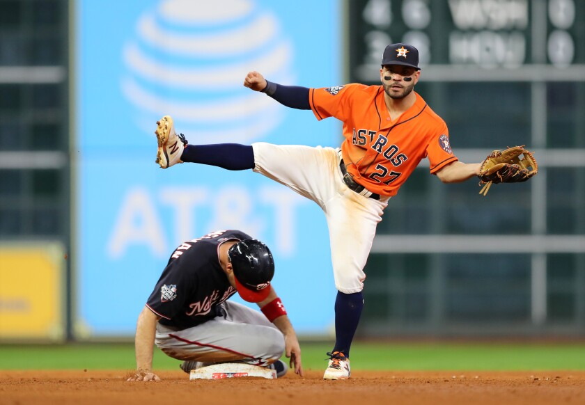 Astros second baseman Jose Altuve gets a force out on Nationals first baseman#Ryan Zimmerman during Game 7 of the 2019 World Series at Minute Maid Park.