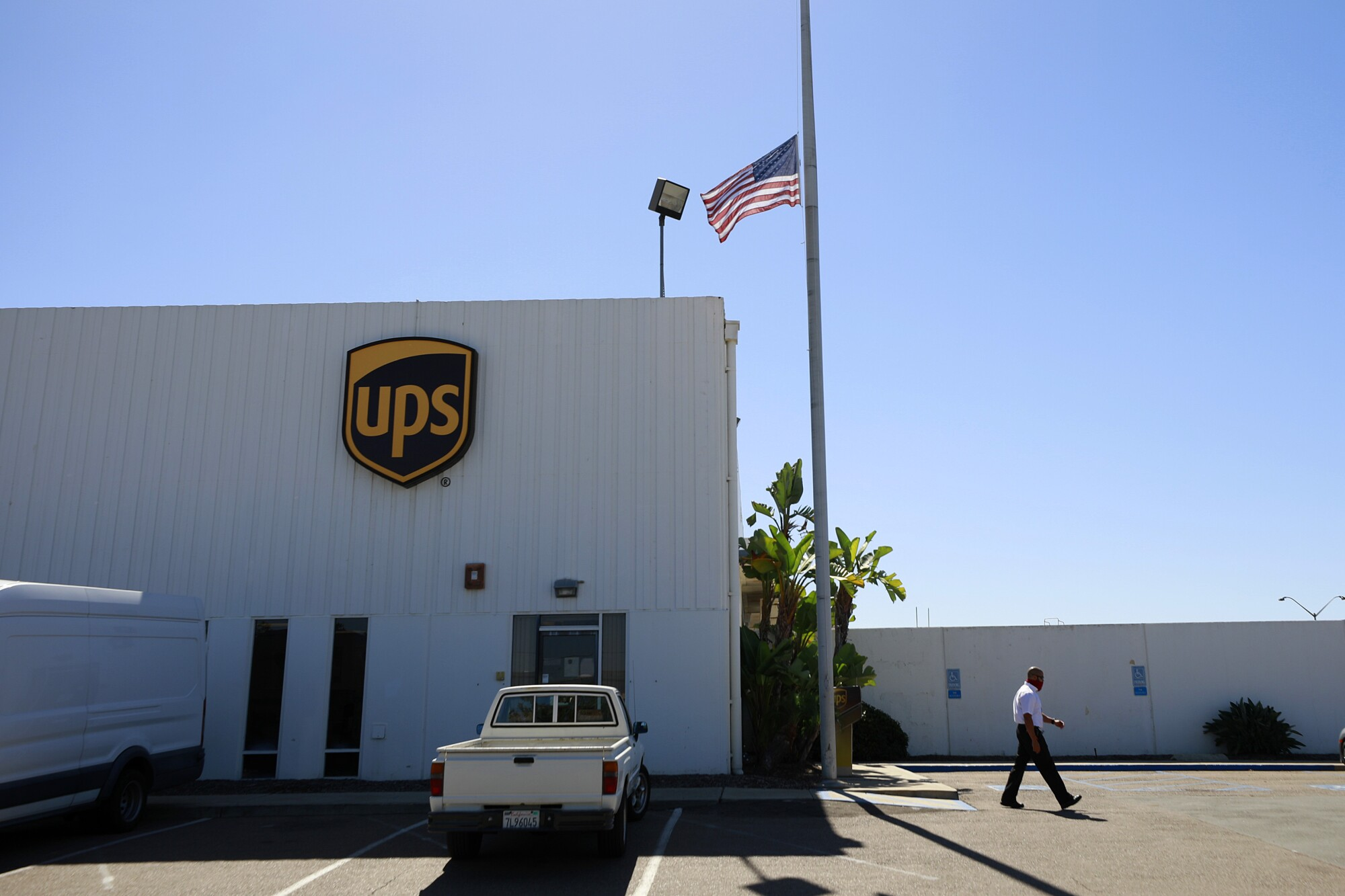 Flags flew at half mast at the UPS facility in Kearney Mesa to honor of UPS driver Steve Krueger.