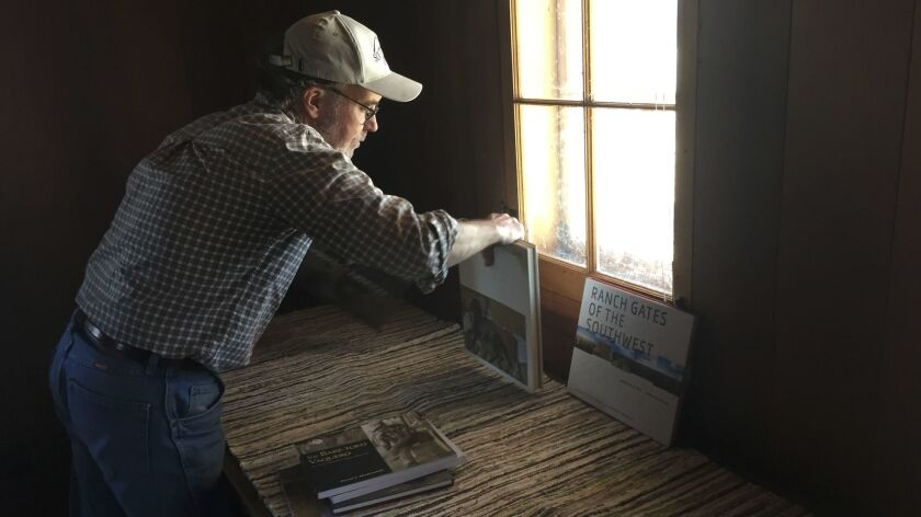 Jeff Lee sets out books in the main house of the Rocky Mountain Land Library. The Rocky Mountain Lan