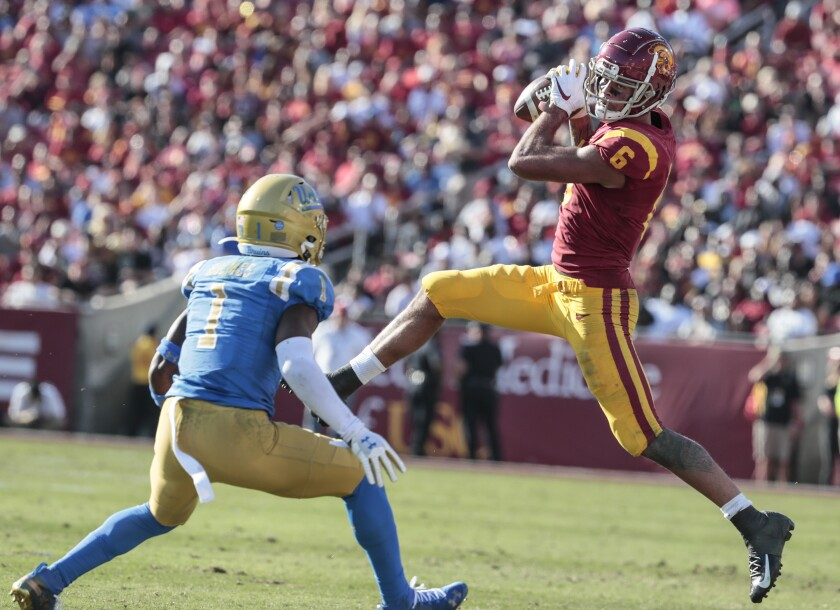 USC receiver Michael Pittman Jr. catches a pass in front of UCLA defensive back Darnay Holmes (1) during a game Nov. 23 at the Coliseum.