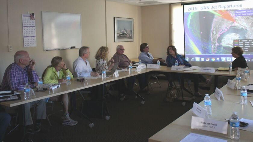 Airport Noise Advisory Committee subcommittee members review FAA slides at the March 15 meeting.