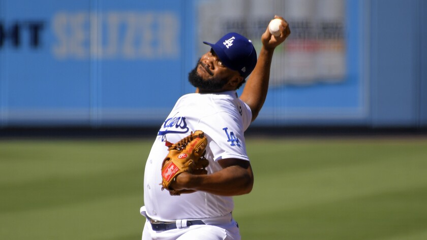 Los Angeles Dodgers relief pitcher Kenley Jansen throws to the plate during the ninth inning.