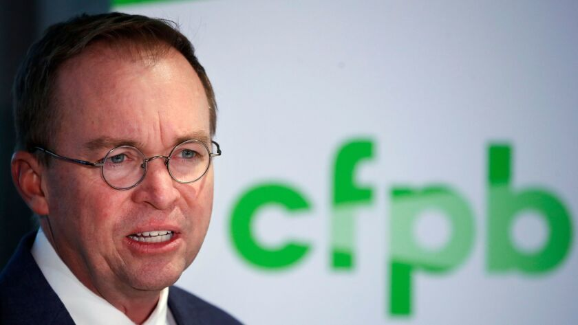 Mick Mulvaney speaks during a news conference after his first day as acting director of the Consumer Financial Protection Bureau on Nov. 27.